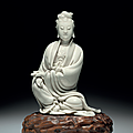 A fine dehua figure of guanyin, ming dynasty, early 17th century, impressed he chaozong mark within a double gourd