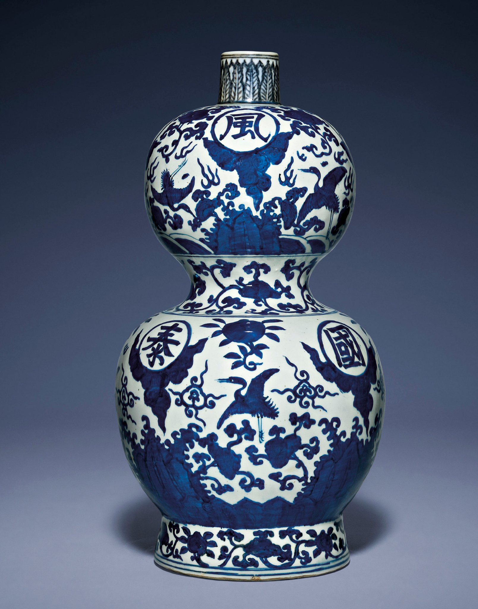 A large blue and white inscribed double-gourd vase, Jiajing six-character mark in underglaze blue and of the period (1522-1566)