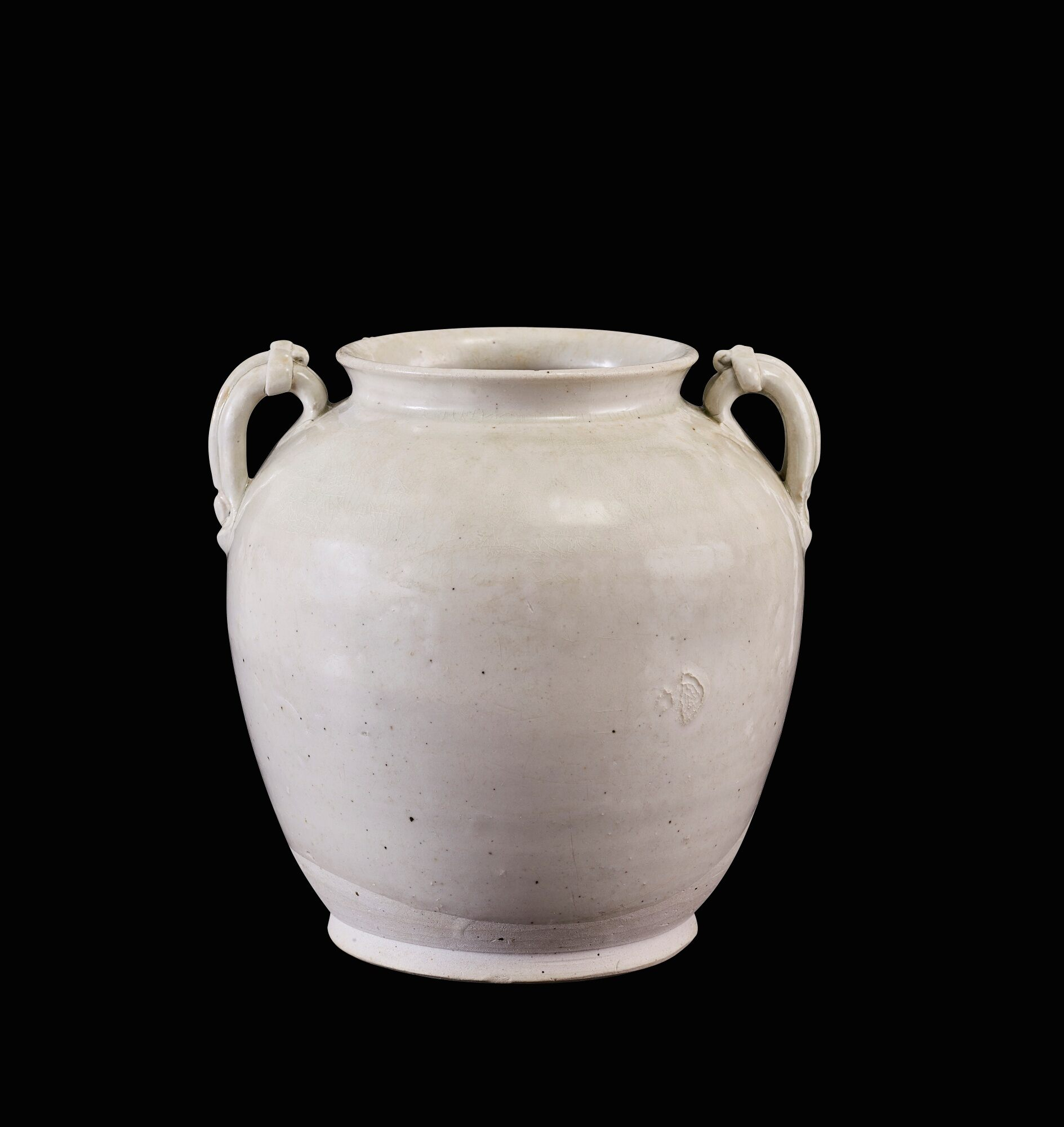A white-glazed handled jar, late Tang-early Northern Song dynasty
