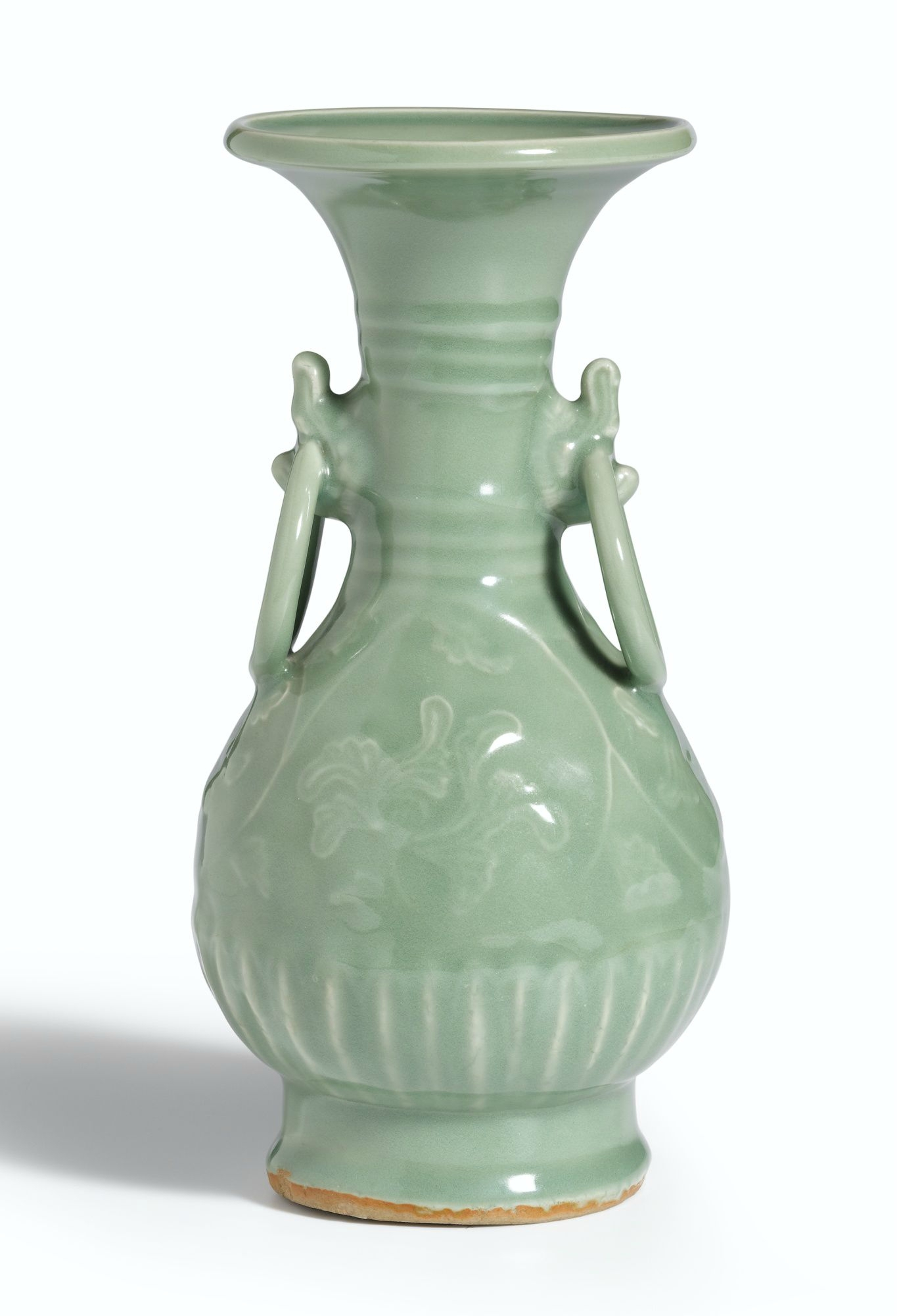 A rare moulded 'Longquan' celadon ring-handled vase, Yuan dynasty