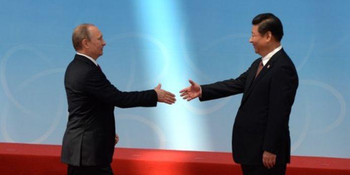 4479970_3_2e7f_le-president-russe-vladimir-poutine-et-le_e6e2847c5182c34200a189febd9d359d
