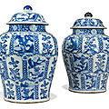 A large pair of chinese blue and white baluster vases and covers, kangxi period (1662-1722)
