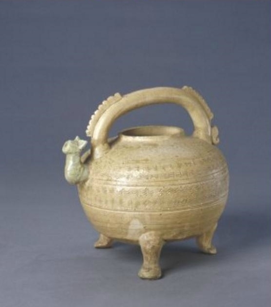 A green yellow glaze pouring vessel, Warring States period, high 17