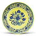 A yellow and blue Ming-style 'lotus bouquet' dish, Qianlong seal mark and period (1736-1795)