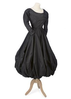 A black silk faille 'balloon' cocktail dress. Eisa, circa 1950.