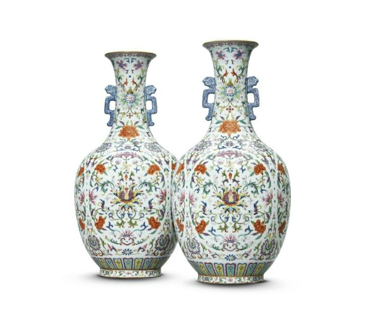 A rare and very finely painted pair of famille-rose vases, Seal marks and period of Jiaqing