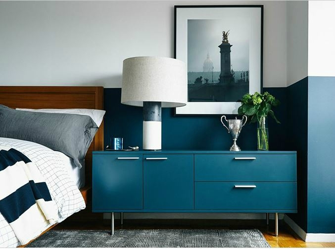 light-and-bright-bedroom-with-teal-dresser-and-matching-colour-blocked-wall-in-teal
