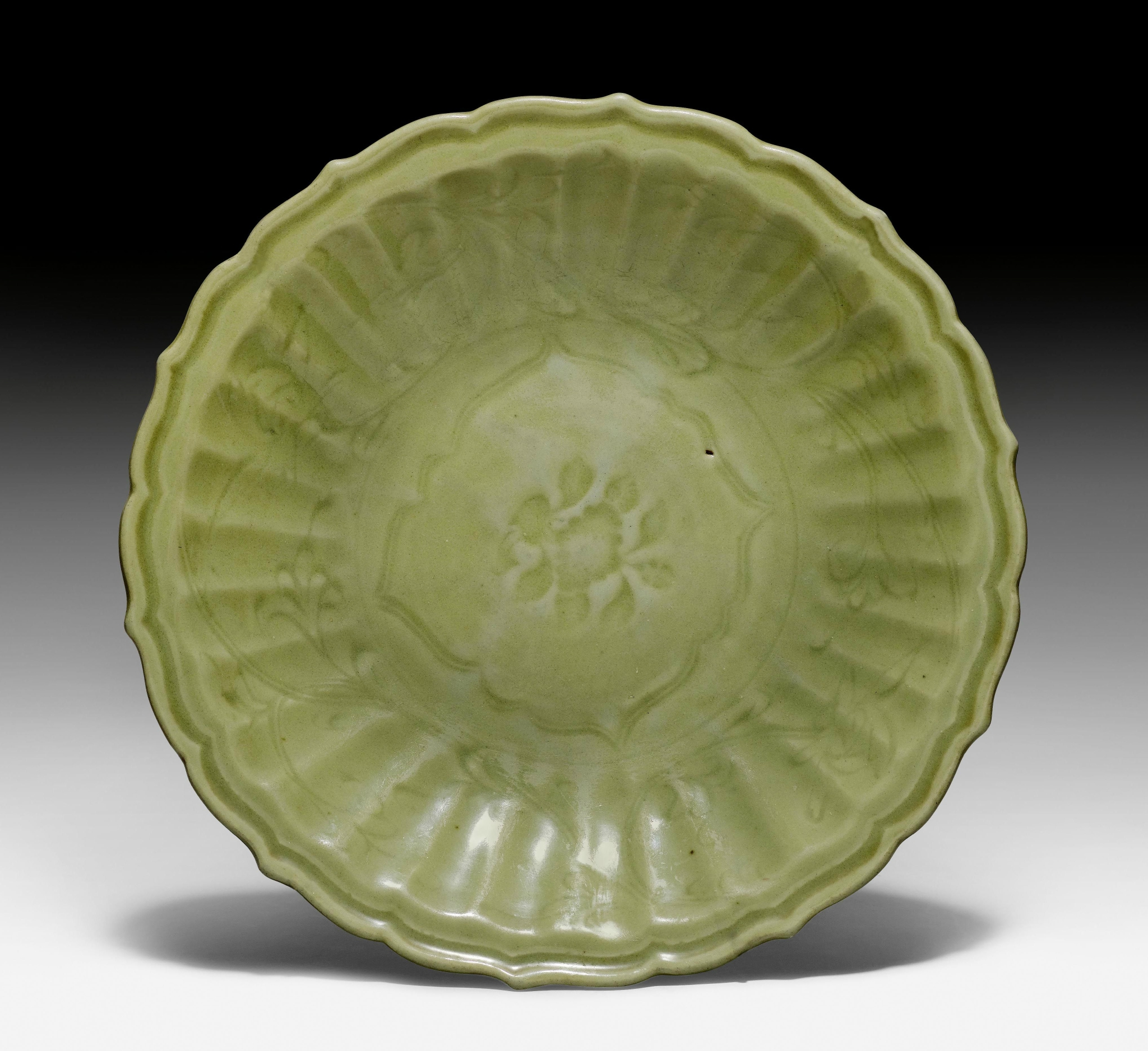 A large lobed and moulded celadon dish with incised floral decoration, China, Ming dynasty (1368-1644)