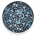 A reverse-decorated blue and white 'dragon' dish, chuxiugong seal mark, qing dynasty, guangxu period (1875-1908)