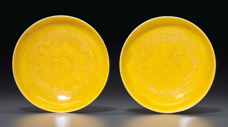 2014_NYR_02872_0899_000(a_pair_of_small_yellow-glazed_incised_dishes_kangxi_six-character_mark)