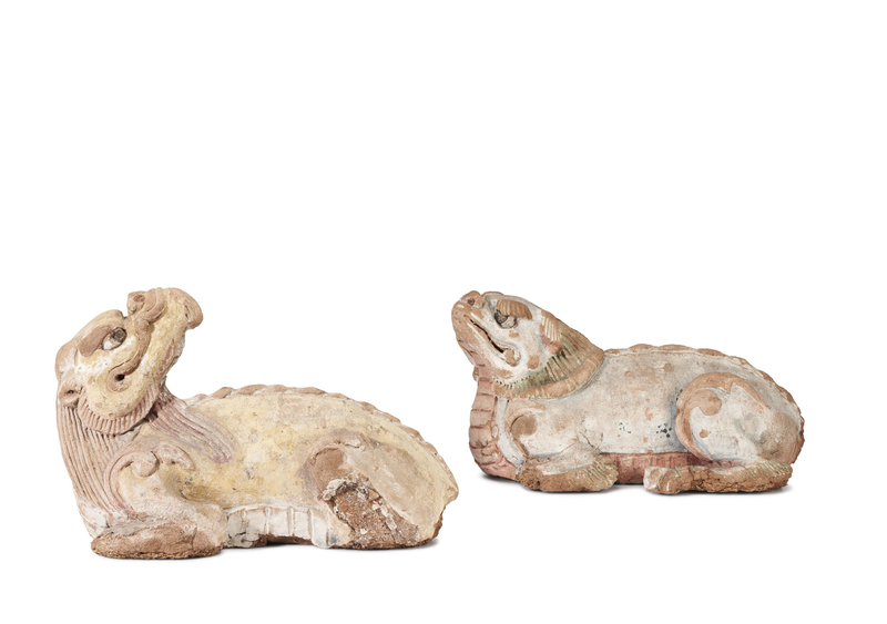 A pair of painted baked mud figures of mythical beasts, Yuan-Ming dynasty (1279-1644)