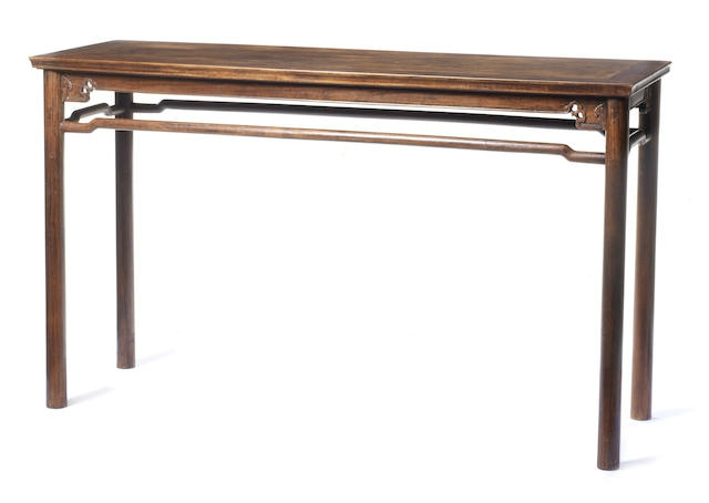 A rare huanghuali rectangular table with humpback stretchers, Ming Dynasty, 17th century