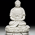 A rare dehua figure of buddha, late ming-transitional period, circa 1640-1660
