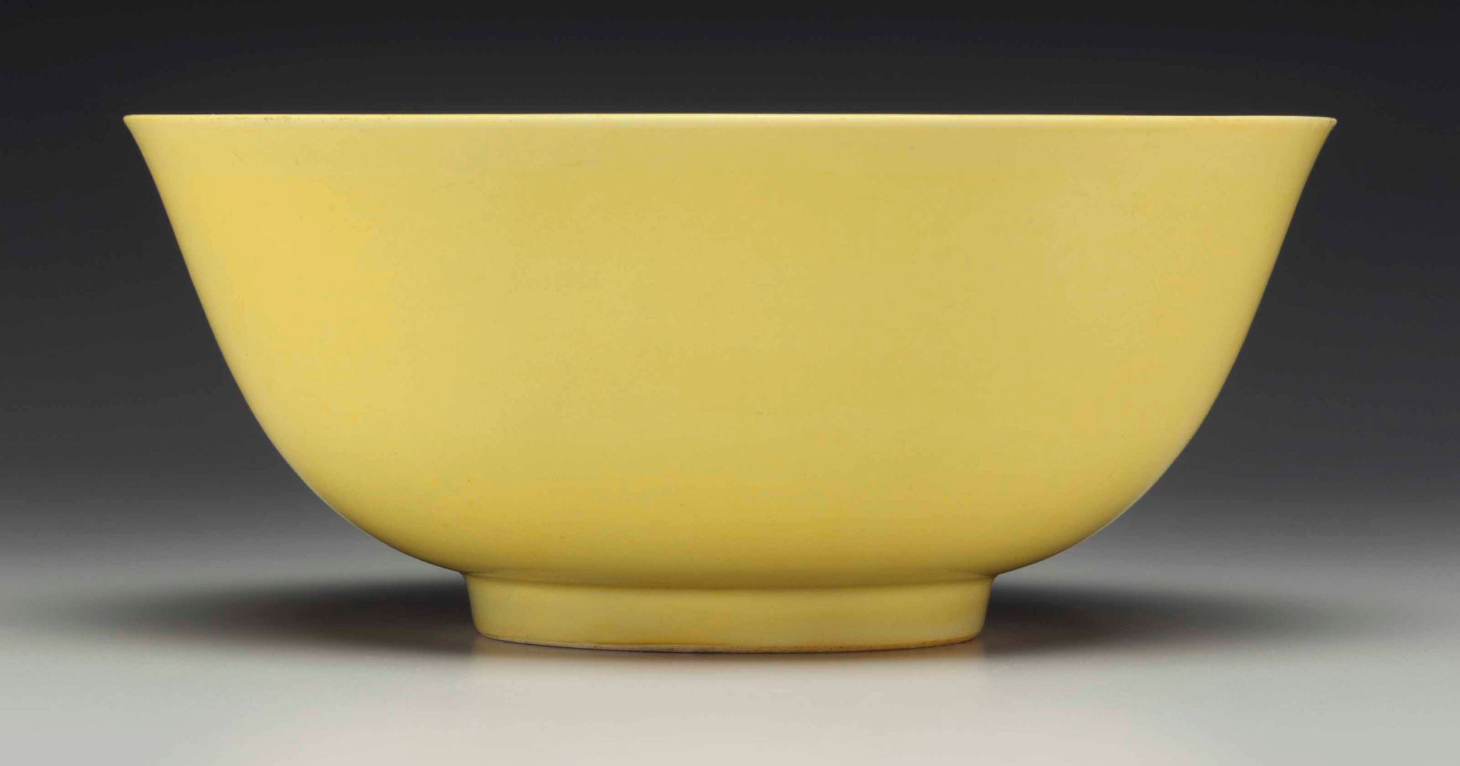An Imperial yellow-glazed bowl, Hongzhi six-character mark in underglaze blue within a double circle and of the period (1488-1505)