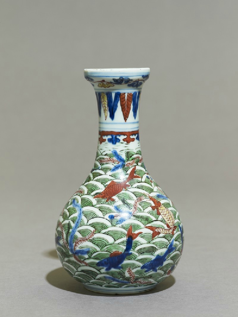 Wucai ware vase with fish amid waves, Ming Dynasty, Wanli Mark and Period (1573 - 1620)