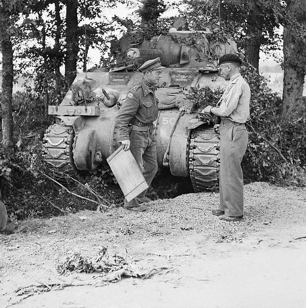 ,_commanding_11th_Armoured_Division,_with_Brigadier_Roscoe_Harvey_of_29th_Armoured_Brigade,_and_a_Sherman_command_tank,_Normandy,_15_August_1944__B9184