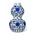 A blue and white double-gourd 'lotus' vase, jiajing six-character mark in underglaze blue in a line and of the period (1522-1566