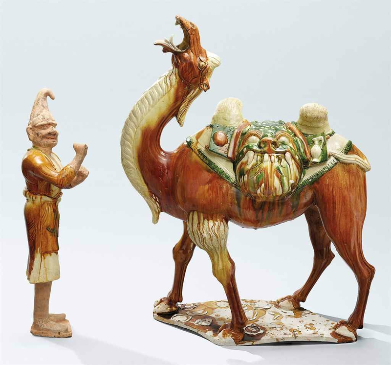 A magnificentsancai-glazed camel and a foreign attendant, Tang dynasty (618-907)