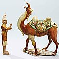 A magnificent sancai-glazed camel and a foreign attendant, Tang dynasty (618-907)