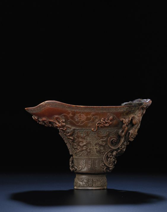 A large and superbly carved archaistic 'chilong' libation cup