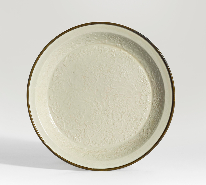 A fine molded 'Ding' dish, Northern Song dynasty (960-1279)