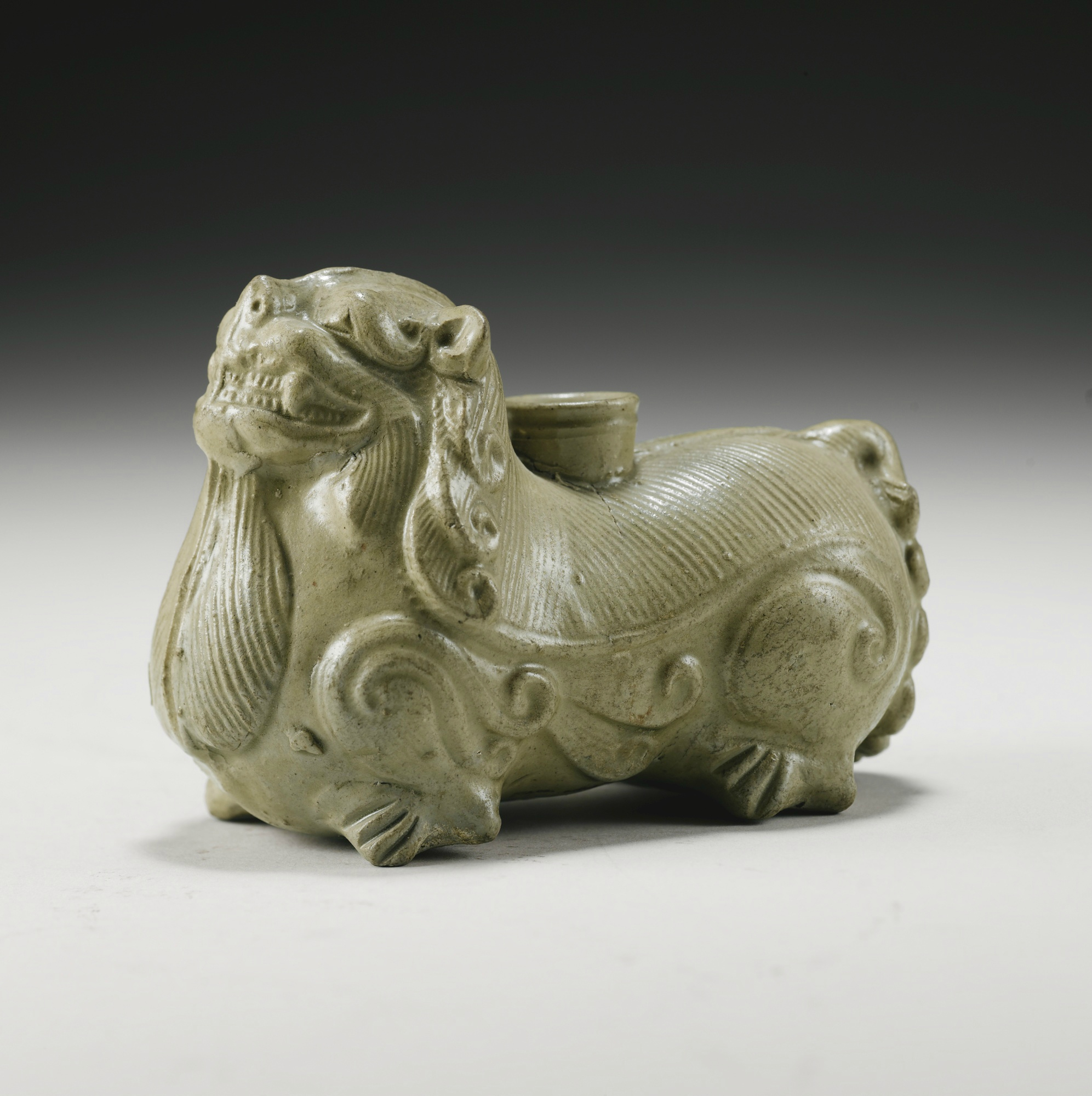 A 'Yue' Green-Glazed 'Lion' Incense Burner, Western Jin Dynasty (265 - 316)