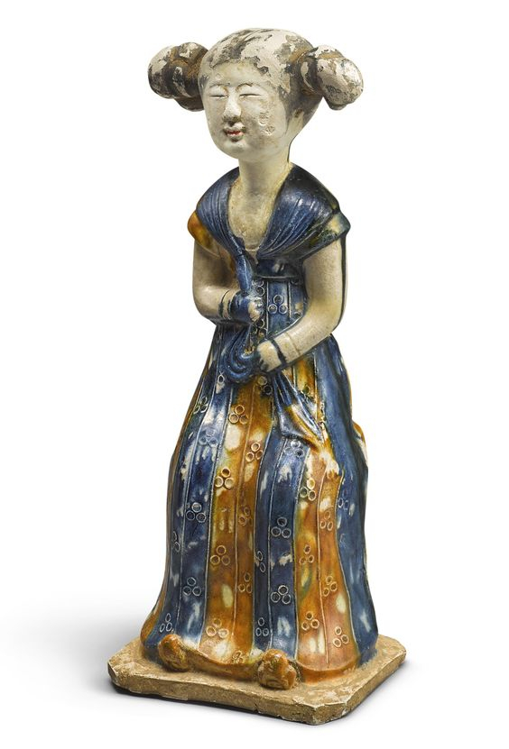 A rare and important blue and amber-glazed pottery figure of a court lady, Tang dynasty