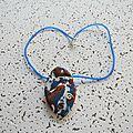 pendentif ogive marbré brun et bleu 7 €