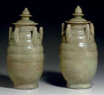 a_pair_of_zhejiang_celadon_carved_five_spout_jars_and_covers_northern_d5348009h