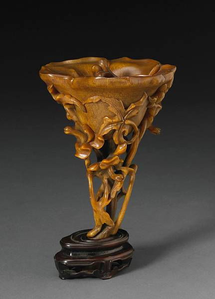 A tall rhinoceros horn libation cup