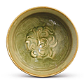 A Yaozhou celadon carved 'Floral' bowl, Northern Song dynasty, 11th-12th century