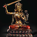 A magnificent and very rare large lacquered and gilt wood seated figure of manjushri, kangxi period (1662-1722)