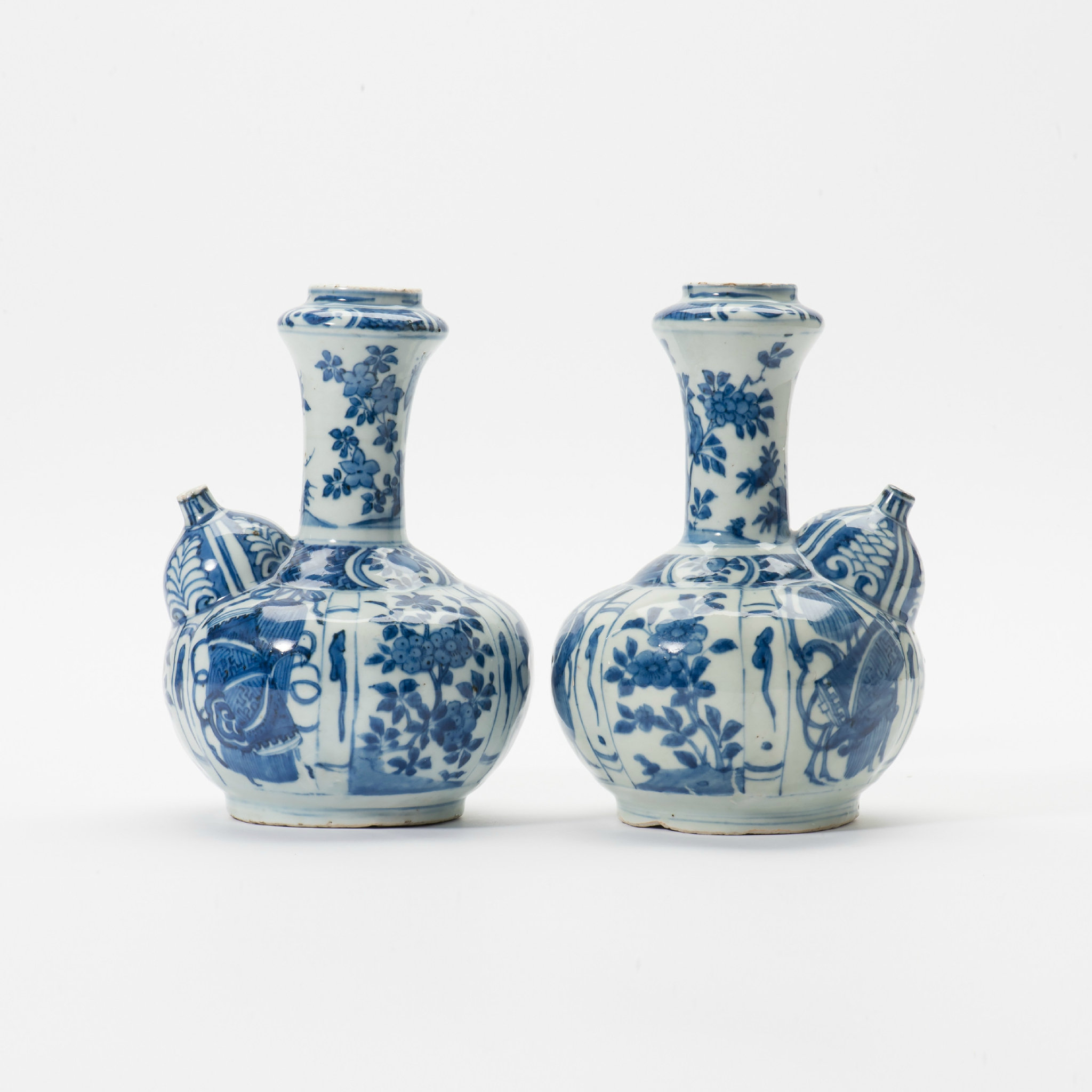 A pair of blue and white Kendi, Wanli period (1573-1619)