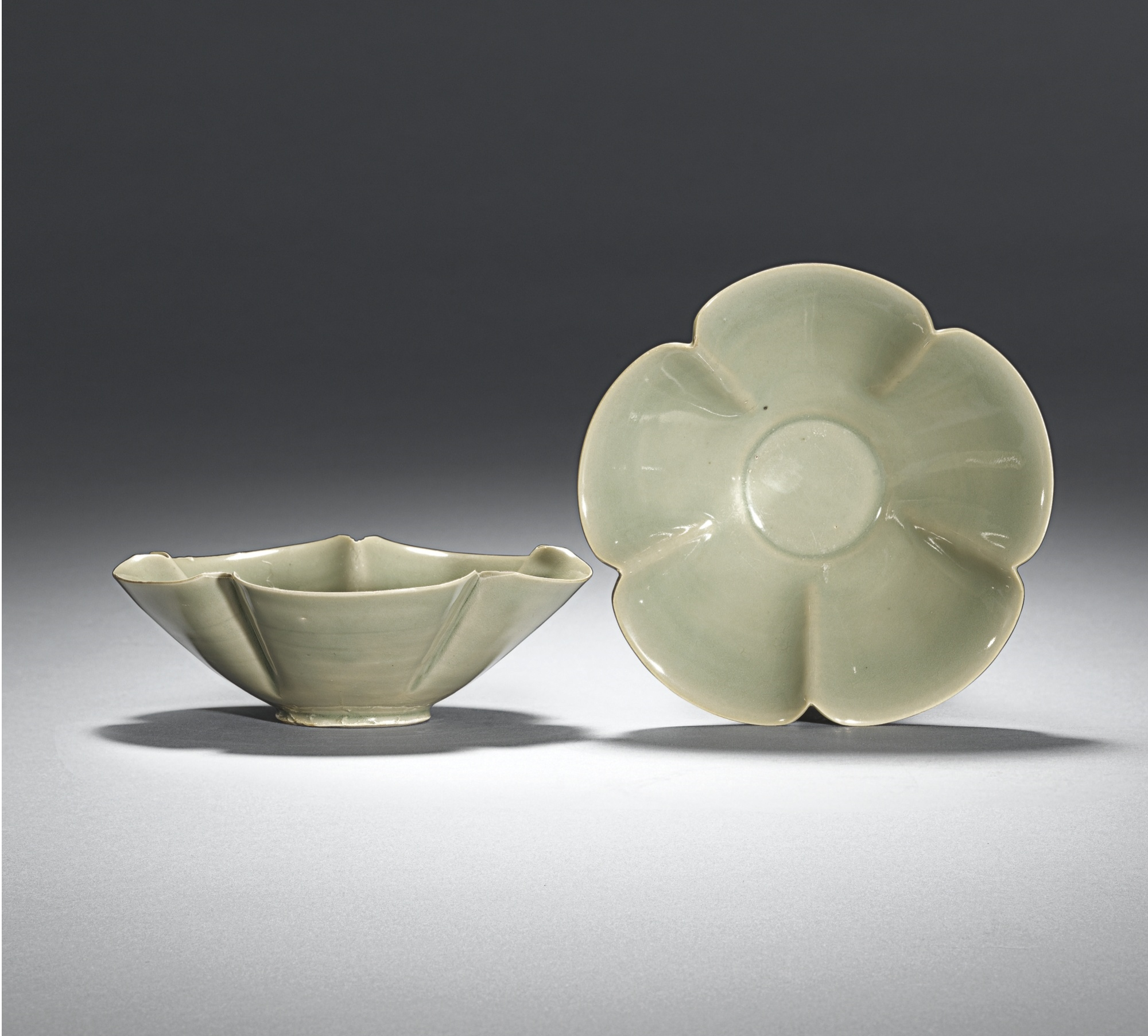 Lot 1. An exquisite pair of Yaozhou flower-shaped bowls, Five dynasties, 10th Century; 12.8cm., 5 1/8 in. Estimate 25,000—30,000 GBP. Lot Sold 67,250 GBP. Photo Sotheby's