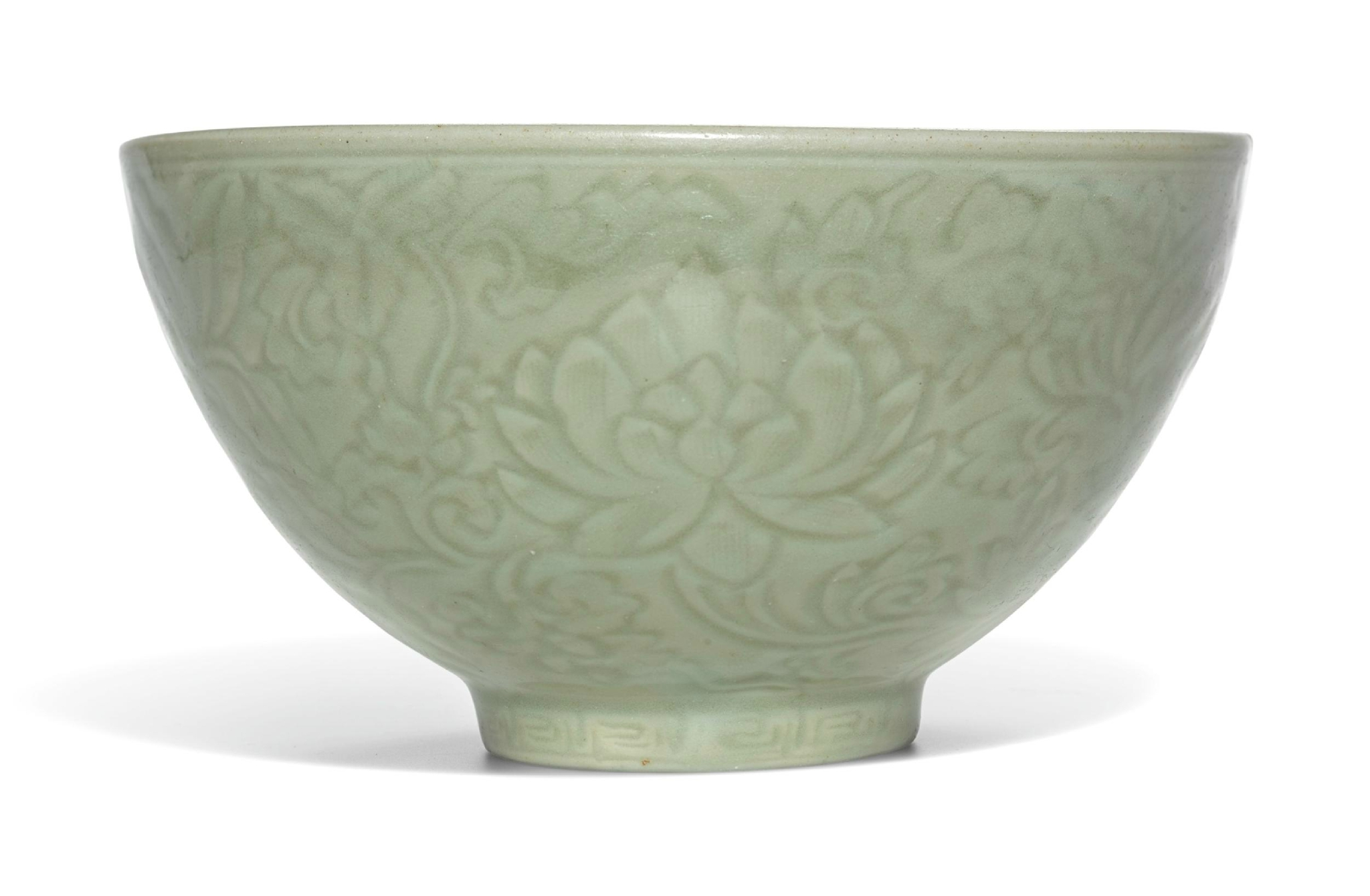 A rare carved 'Longquan' celadon bowl, Ming Dynasty, early 15th century